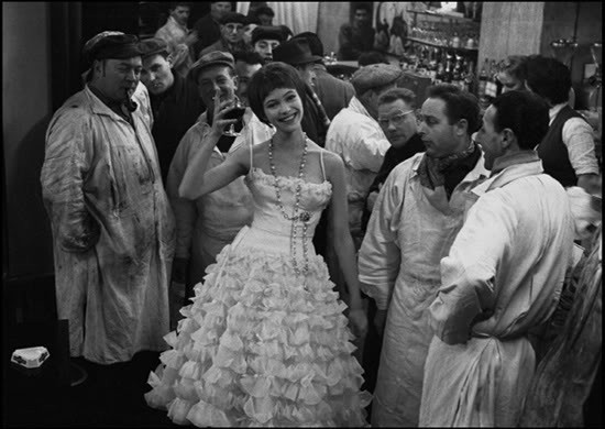 Actress Anna Karina in coctail dress at Les Halles, the food market of Paris, 1959